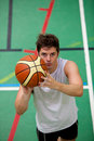 Muscular young man playing basket-ball Stock Photos