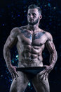 Muscular young man standing shirtless Royalty Free Stock Photo
