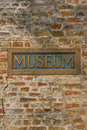 Museum on brick vintage metal sign inlaid in a wall Royalty Free Stock Image