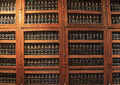 Museum of expensive vintage wine madera funchal madeira october the shelves are made with sweet bottles long rows shelves made Royalty Free Stock Photos