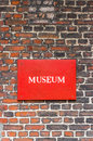 Museum sign on brick red attached to a wall Royalty Free Stock Images