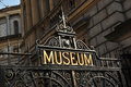 Museum sign on old metallic gate Royalty Free Stock Photography
