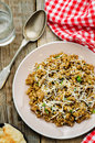 Mushroom and barley stew with cheese on a dark wood background tinting selective focus Stock Images