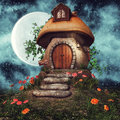 Mushroom cottage with flowers Royalty Free Stock Photo