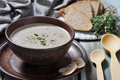 Mushroom cream soup with herbs in brown bowl over wooden background Royalty Free Stock Photography