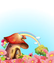 A mushroom house above the hill with a garden illustration of Stock Photos