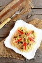 Mushroom pasta with vegetables on a plate. Homemade pasta with roasted mushrooms, red pepper and green onions. Vegetarian dish Royalty Free Stock Photo