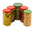 Mushroom peppers cucumbers tomatoes pease preserved glass pots jars isolated white background ecological natural food resource Stock Photography