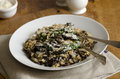 Mushroom risotto with spinach topped with grated parmesan Royalty Free Stock Images
