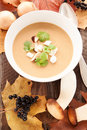 Mushroom soup on a brown wooden background Royalty Free Stock Photography
