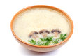 Mushroom soup with dill plate on a white background Stock Image