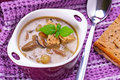 Mushroom soup with potato and croutons Stock Images