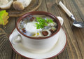Mushroom soup with sour cream and in the bowl on the table Royalty Free Stock Photography