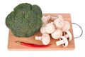 Mushrooms broccoli pepper on the cutting board Royalty Free Stock Photography