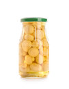 Mushrooms glass jar canning isolated over white background Royalty Free Stock Photo