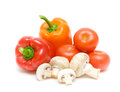 Mushrooms and vegetables on a white background close up tomatoes bell peppers horizontal photo Stock Photos