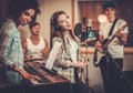 Music band performing in a studio Royalty Free Stock Photo
