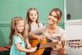 Music class in the kindergarden teacher playing Stock Photo