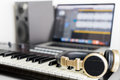 Music computer studio with golden headphone Royalty Free Stock Photo
