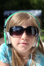 Music girl young listening to outside while wearing sunglasses Stock Photo