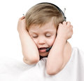 Music lover happy closing eyes boy with headphones on white background Stock Images