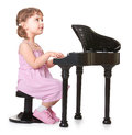 Music in my heart little girl playing on a miniature piano Stock Photography