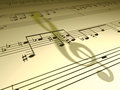 Music note shadow of a treble clef on sheet Stock Photo