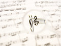 Music note sheet with a hand glass Royalty Free Stock Photo