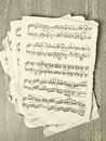 Music notes on old paper close up Stock Images