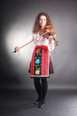 Music performer with violin in Bulgarian costume Royalty Free Stock Image