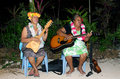 Music of polynesian pacific island in aitutaki lagoon cook islan portrait tahitian mature females sing a song and play with Royalty Free Stock Photo