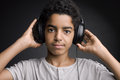 Music portrait of african teenager listening with headphones Royalty Free Stock Photography