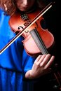 Music portrait of young woman violin play close up face beautiful model Stock Photos