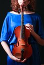 Music portrait of young woman violin play close up face beautiful model Royalty Free Stock Images