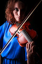 Music portrait of young woman violin play close up face beautiful model Stock Images