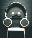 Music Robot using headphone cassette tape and tablet Royalty Free Stock Photo
