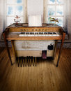 Music room with organ an old in an old a wooden floor a blank sheet Royalty Free Stock Photos