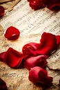 Music sheets with rose petals Royalty Free Stock Photo