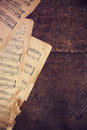 Music sheets on wooden background Royalty Free Stock Photo