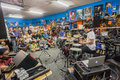 Music shop drum demo people with sid rash doing tuition and teach talk with arrors christie before folk at glenwood Royalty Free Stock Image