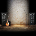 Music stage or singing background microphone guitar and speakers with wood flooring advertising concept with room for text copy Stock Image