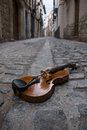 Music of the street photo taken in a small cobbled with a violin on floor Stock Photos