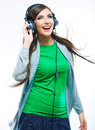 Music teenager girl dancing against isolated white background woman with headphones listening teen life style concept Stock Photography