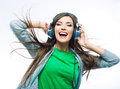 Music teenager girl dancing against isolated white background woman with headphones listening teen life style concept Royalty Free Stock Photo