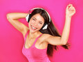 Music woman wearing headphones dancing listening to on mp player or smart phone fresh energetic happy multiracial asian Royalty Free Stock Image