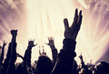 Musical concert grunge style photo of silhouette of people hands raised up on enjoying music dance club active night life concept Royalty Free Stock Image