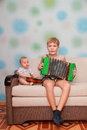 Musical ensemble of two brothers guitar and accordion Royalty Free Stock Images