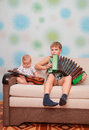 Musical ensemble of two brothers guitar and accordion Stock Photography