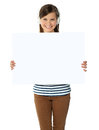 Musical girl promoting blank banner ad Royalty Free Stock Photo