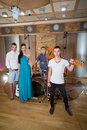 Musical group of three guys and one girl in Recording Studio Royalty Free Stock Photo